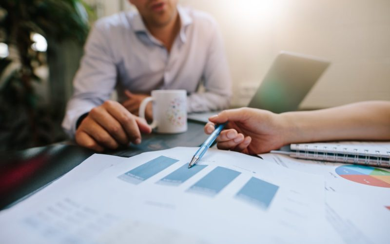 business-people-discussing-financial-statistics-P8ZERUY-min