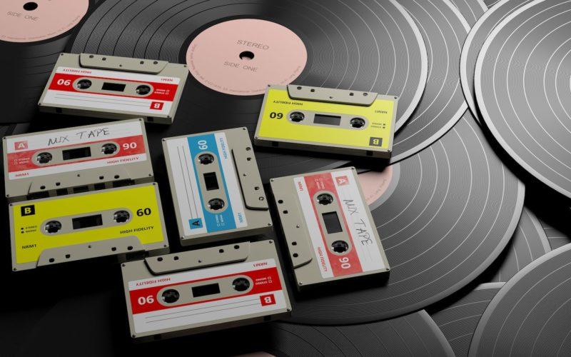 vintage-audio-cassettes-on-wooden-background-mix-A568FPS-min